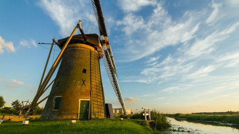 LEIDEN, THE NETHERLANDS - 28 JULY 2013: Time-lapse of a beautiful sunny day with clouds moving over an old windmill in Leiden (The Netherlands)