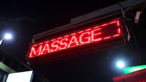 Red neon sign of the word 'Massage', Chiang Mai, Thailand.