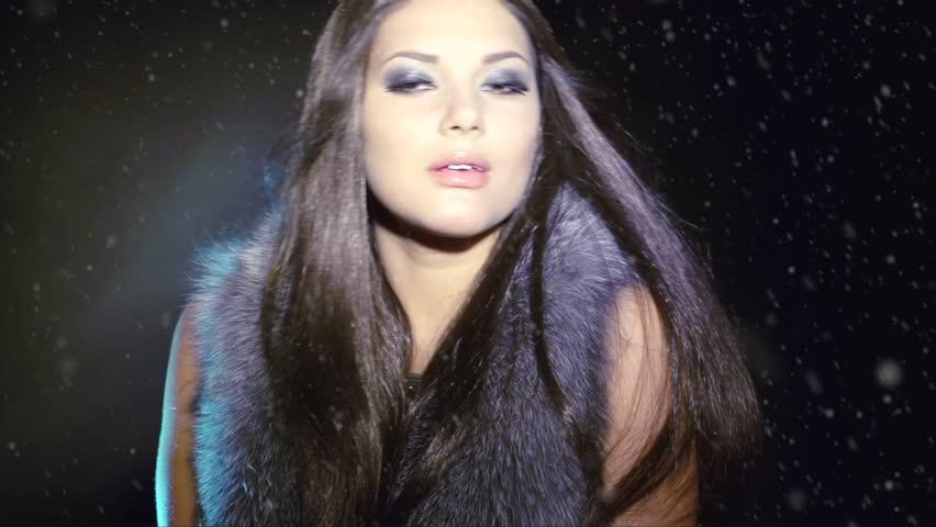Beauty Fashion Model Girl in Fur Coat. Beautiful Woman in Luxury Silver Fox Fur Jacket. Waistcoat. Winter Fashion. Fashion Makeup. Blowing Hair in the snow. Slow motion shot 240fps