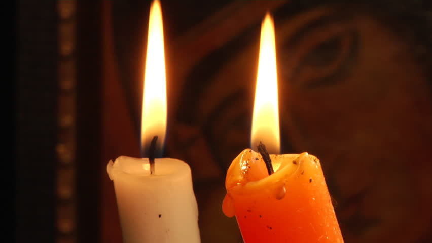 Stock video of candle and christian orthodox icon