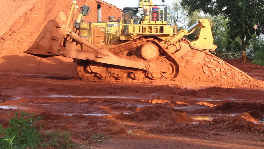 Piles of mining Bauxite in Weipa, Queensland, Australia Bauxite is an aluminum ore and is the main source of aluminum. Big bucket scoop bulldozer mining technology using to move bauxite mine.