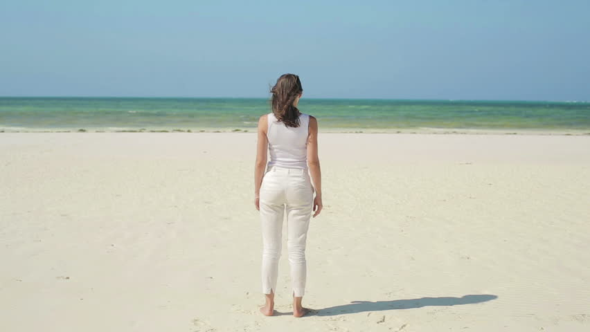 Woman standing on beautiful exotic beach