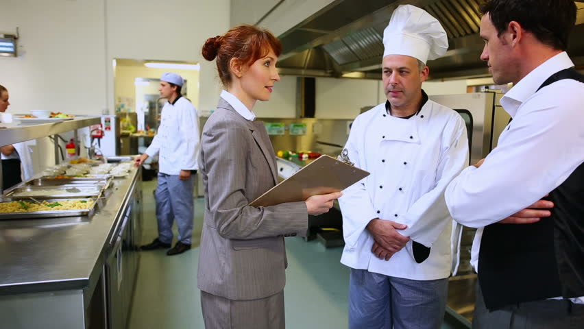restaurant manager chatting with waiter stock footage video 100 royalty free 5659757 shutterstock - Kitchen Manager