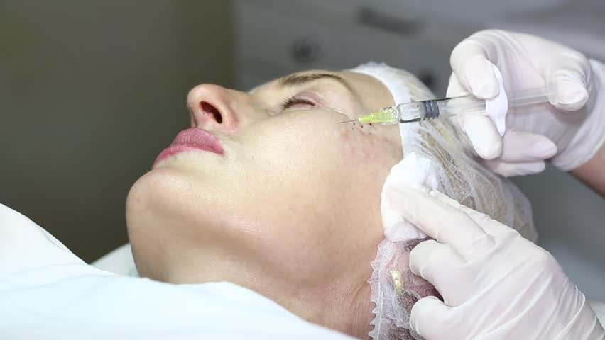 Cosmetic treatment with botox injection in a clinic | Shutterstock HD Video #5667047