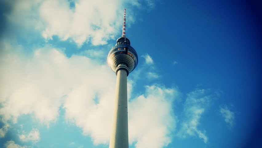 tv tower in berlin with clouds moving behind