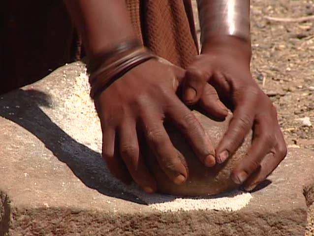Himba grinding wheat