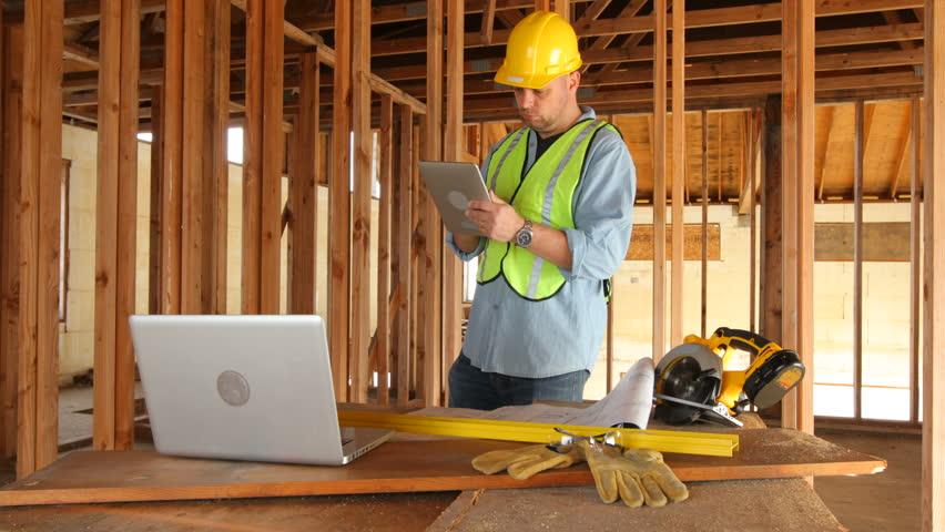 Construction worker using digital tablet on work site.  4K / Ultra HD | Shutterstock HD Video #5674487