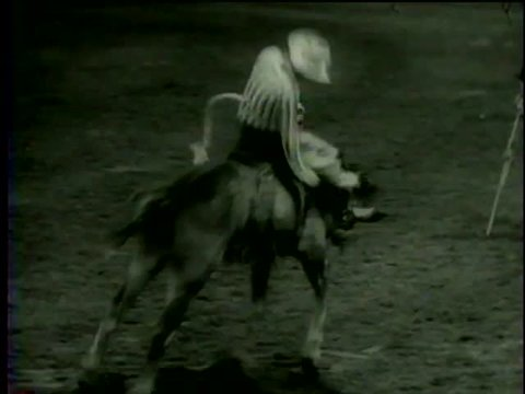 A horse rider on horse back falls during his performance at Santa Rosa Roundup PRCA Rodeo in Vernon, TX circa 1958 - MGM PICTURES, UNIVERSAL-INTERNATIONAL NEWSREEL, USA, filmed in 1958