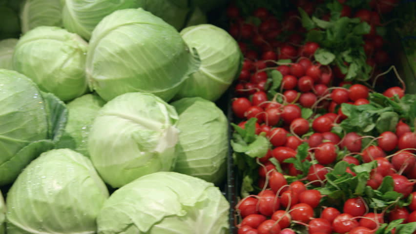 Close-up moving past fresh vegetables in a supermarket grocery. Includes cabbage, celery, broccoli, lettuce, carrots, corn, onion, etc. Wide and medium shots of same set-up are in my portfolio. | Shutterstock HD Video #5695412