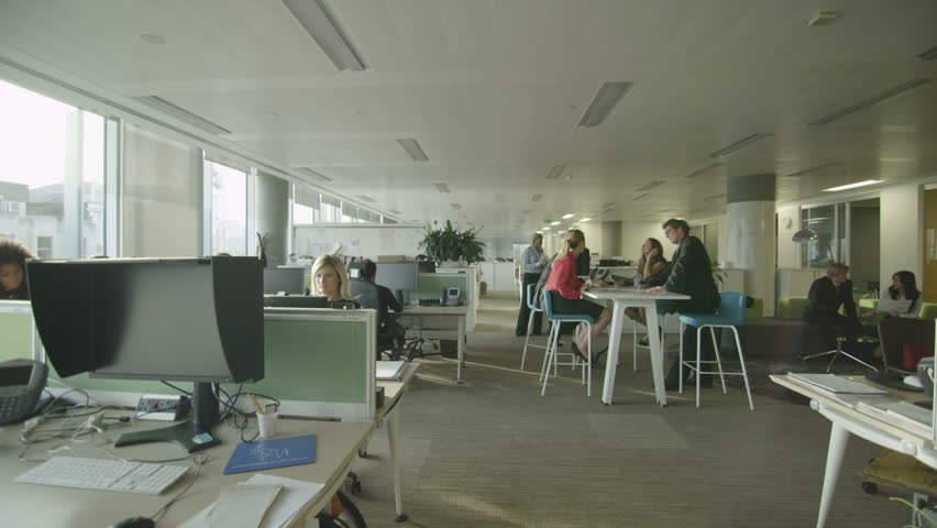 Attractive diverse business group working together in large modern city office.