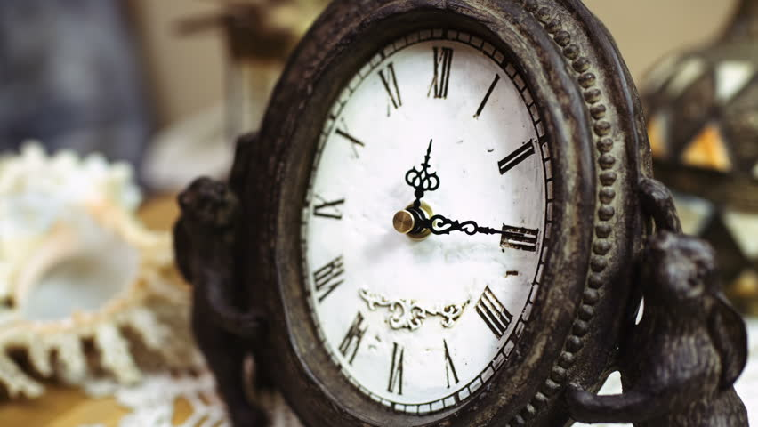 Time-lapse of beautiful, antique clock with decorations. Fine pattern of cracks formed on old clock-face. Passing of time, (hd, high definition, 1920x1080, 1080p) close-up shot