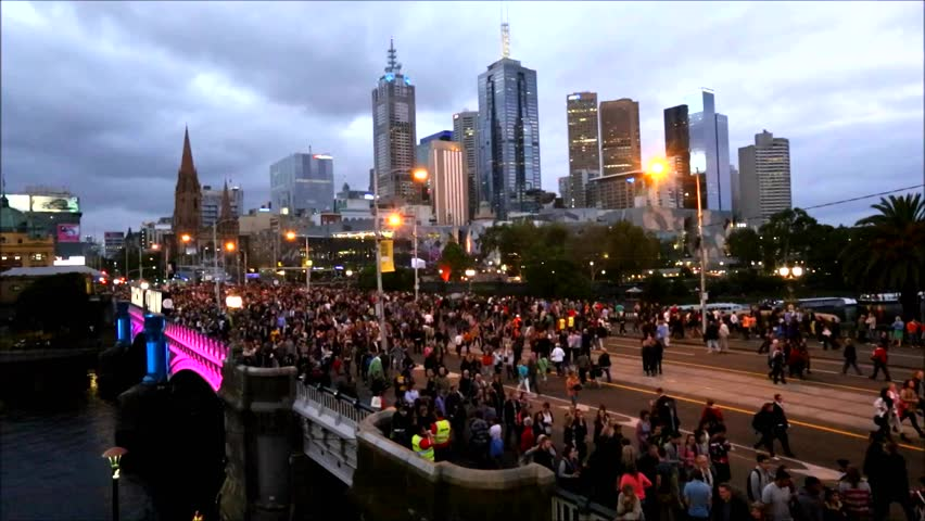 MELBOURNE, AUSTRALIA - FEBRUARY 22,2014: Crowds flock to Melbourne's White Night, which attracted more than 500,000 visitors to the city centre and lit up its buildings as works of art