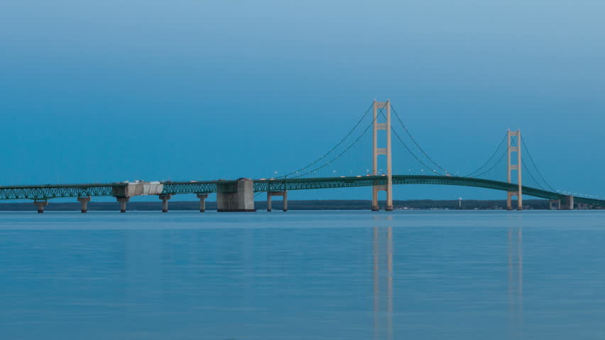 Sunset Time lapse Mackinac Bridge, between Michigan's upper and lower Peninsulas at Twilight, USA, zoom out
