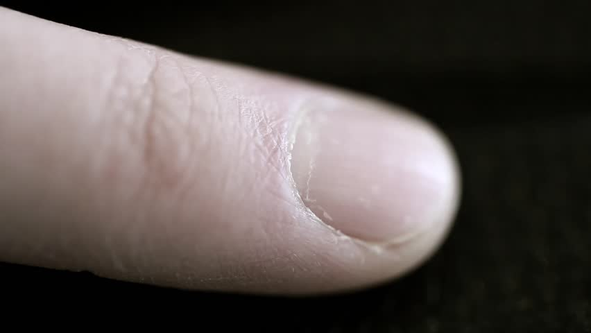 A macro shot of fingerprints on an index finger from a male hand | Shutterstock HD Video #5752007
