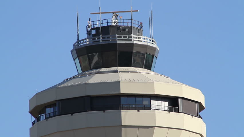Jet Flies Over Airport Control (radar) Tower for Air Traffic Control