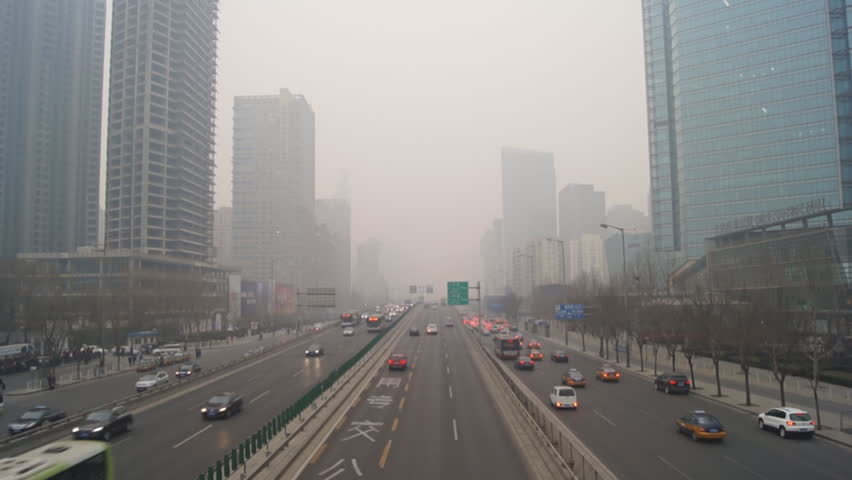 Beijing City Traffic. China's capital city of Beijing street traffic of automobiles, real time. Foggy winter day, smog, air pollution. February 22, 2014.
