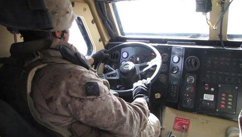 U.S. Marine Drives in Combat Gear Drives a Humvee