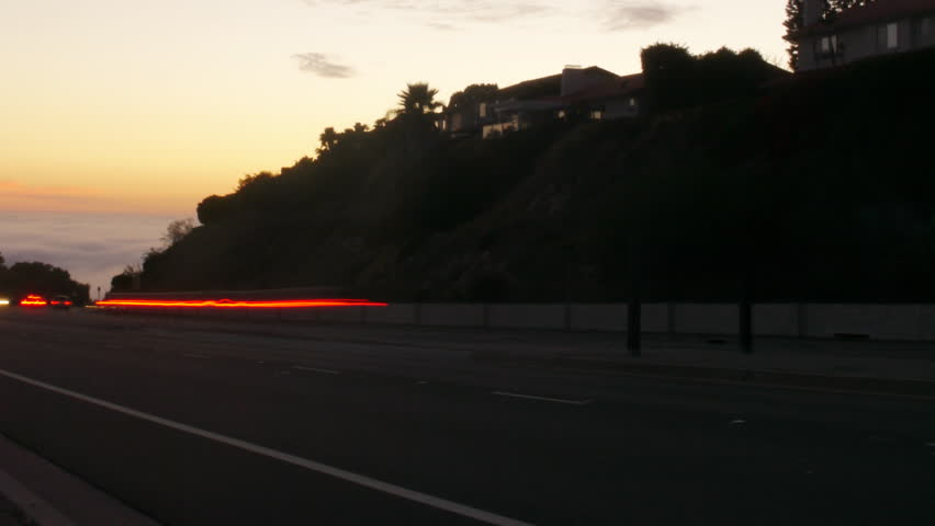 Time Lapse of Traffic on Foggy Coast at Twilight -Pan- | Shutterstock HD Video #5778137