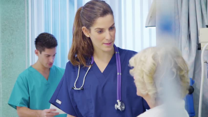 Medical staff working together and taking care of patients on a hospital ward.  | Shutterstock HD Video #5783147