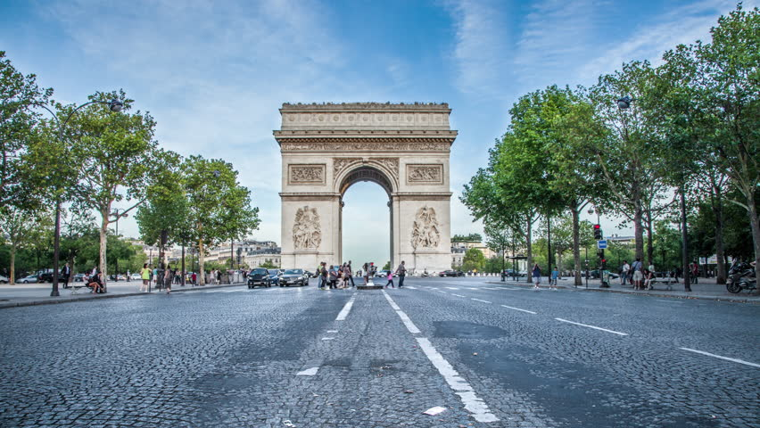 PARIS - CIRCA OCTOBER, 2012: timelapse of Arc de Triomphe from day to night in 4K in Paris. Arc de Triomphe is one of the most famous monuments in Paris, in the centre of the Place Charles de Gaulle.