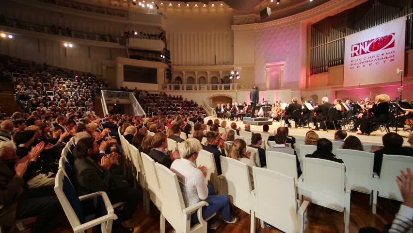 MOSCOW, RUSSIA - SEP 8, 2012: Spectators look at musicians and applaud at IV Grand Festival of Russian National Orchestra in Tchaikovsky Concert Hall. | Shutterstock HD Video #5828600