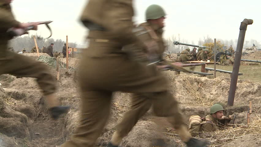 KIEV, UKRAINE - NOVEMBER 04, 2013 : 04.11.2013. Reconstruction of the hostilities of the Second world war in Kiev. The soldiers are forcing the Dnieper river near Kiev, and attack the enemy.