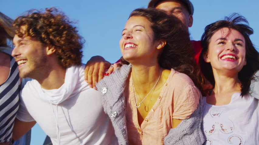 Portrait of happy attractive young group of friends having fun together outdoors on a summer day. In slow motion. #5841470