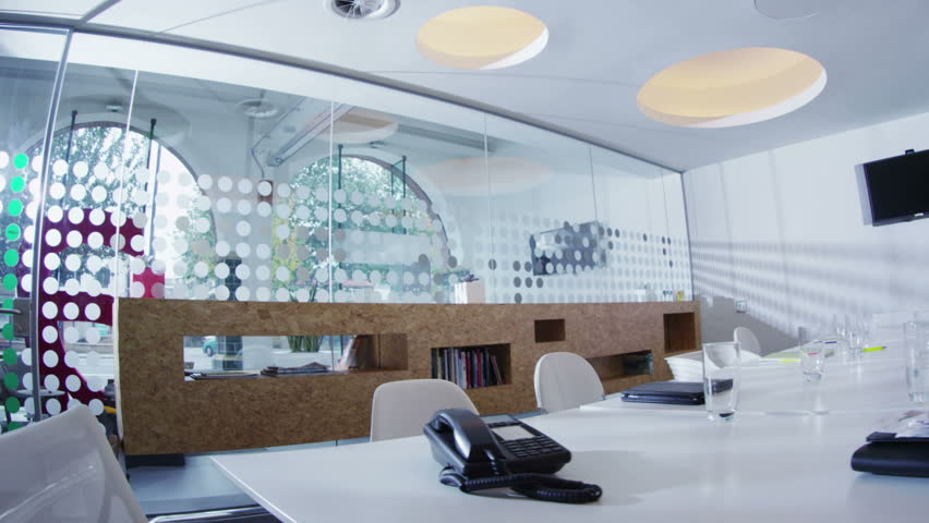 Interior view of boardroom in creative office space. No people