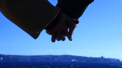 Detail of two lovers joining hands in ISTANBUL