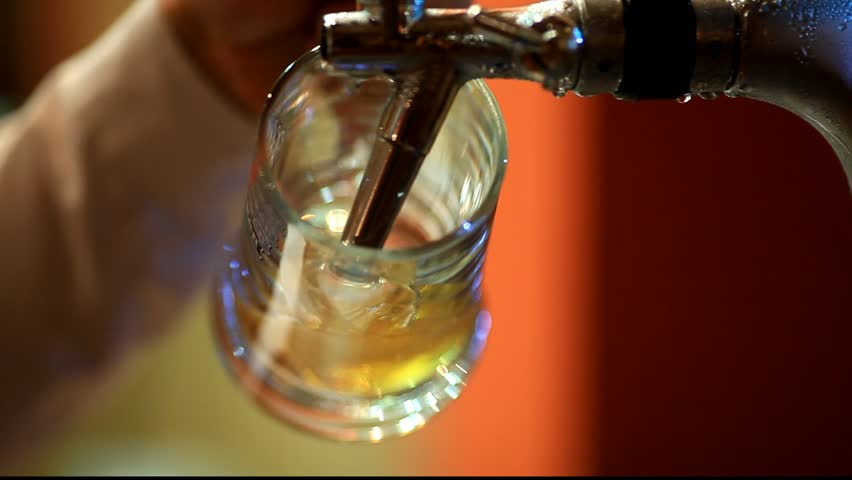 Bartender Pouring Draft Beer #5869751