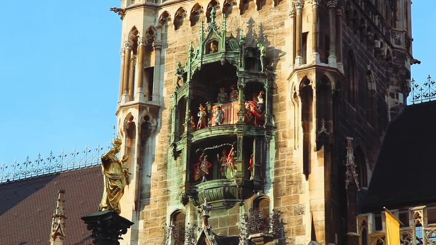 Glockenspiel Clock in Munich's Marienplatz on the City Hall wall. with origianl sound (1920x1080, hd, high definition, hidef, 1080p) evening shot with nice shadows and warm light