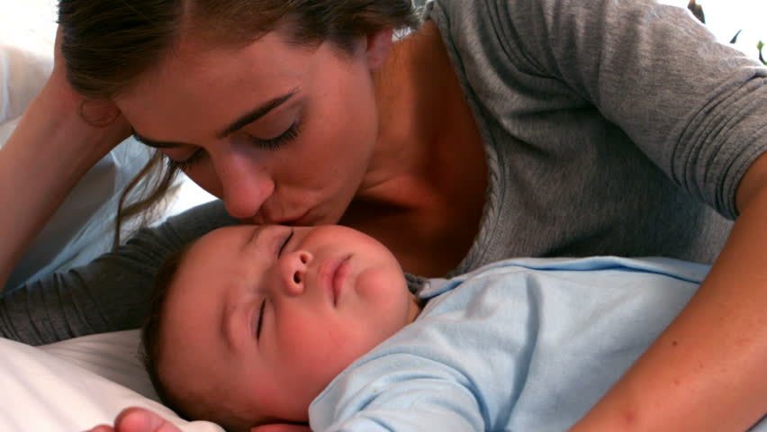 Mother And Her Little Daughter Sleep On Bed, Then They Wakes And Mom Kiss Girl -7553