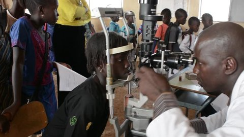 MATAM,SENEGAL-CIRCA NOVEMBER 2013:ophthalmologist visit children at an elementary school in the village of Matam in Senegal. Twice a year the pupils are visited in the eyes,circa Nov. 2013