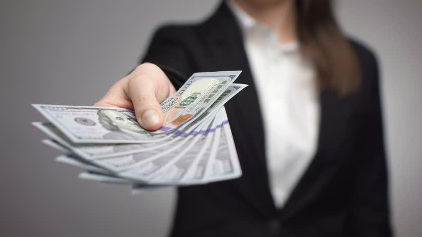businesswoman offering hundred dollar bills #5938367