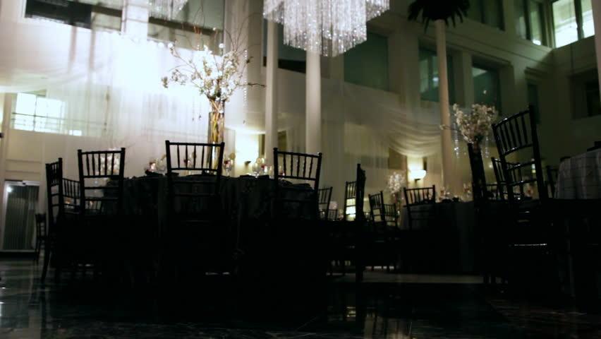 Wide of a dark banquet hall.