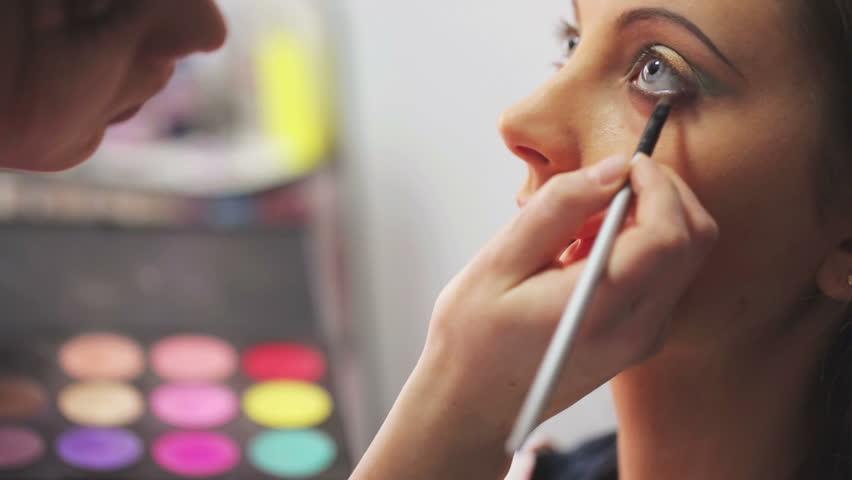 Makeup artist makes models eye makeup   Shutterstock HD Video #5989757