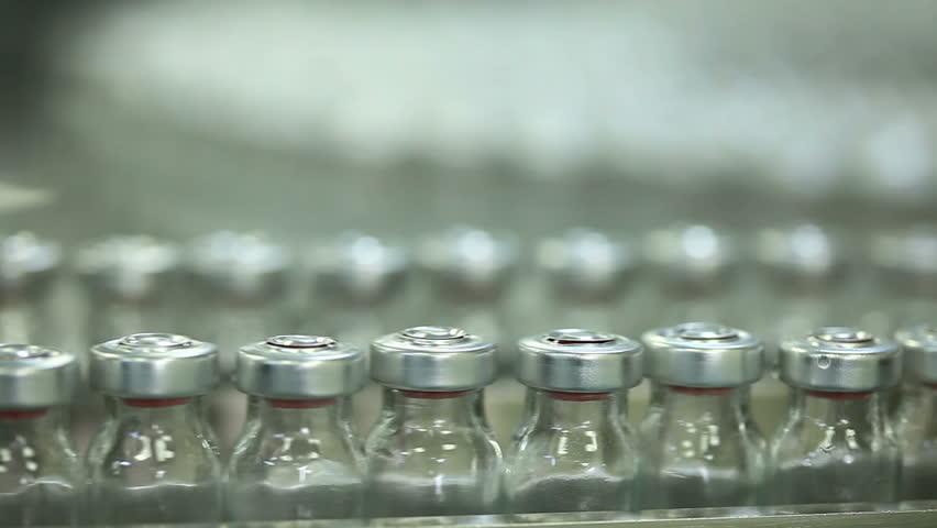 medicine bottles in pharmaceutical machine