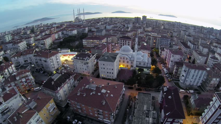 Crowded city of Istanbul. High altitude city night scene at Maltepe, Turkey. Drone taking off.