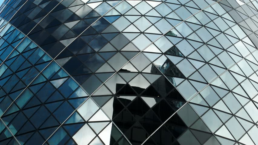 London, UK - March 22, 2014: Close detail time lapse footage of a fractured cloudscape reflected on the panes of glass of a modern skyscraper; The Gherkin, London. | Shutterstock HD Video #6024437