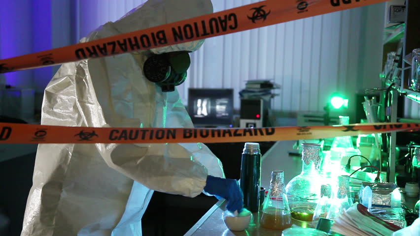 Scientist behind the caution tape laboratory with equipment