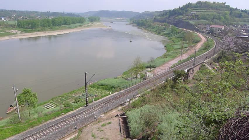 Locomotive Of A Train Is Moving Rapidly Along River With Sound