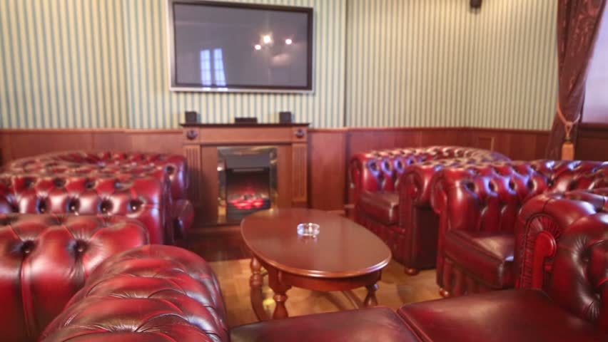 Luxurious cigar room with red leather armchairs and TV #6051416