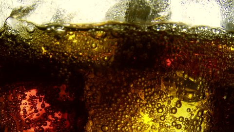 cola soft drink bubbles & ice, soda close-up