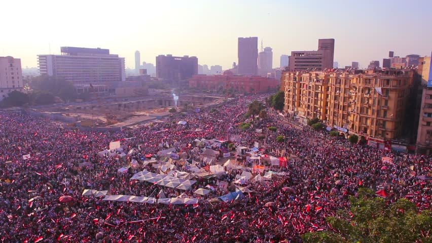 Overhead view as protestors jam Tahrir Square in Cairo, Egypt in the early morning hours.