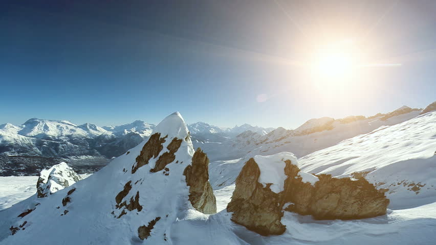 Overlooking snow mountains. aerial view. fly over. epic alps panorama. winter landscape  | Shutterstock HD Video #6065243