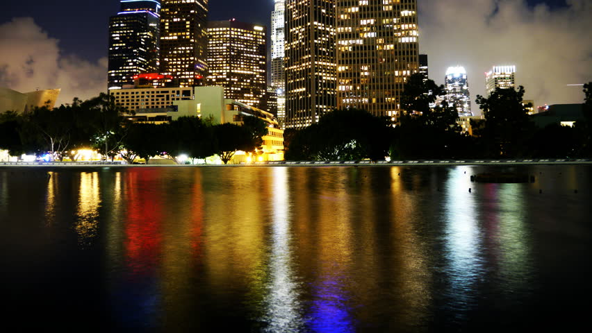 4K Time Lapse of Downtown Los Angeles with Water Reflection and Cloud Storm Rushing in at Night -Tilt Up-
