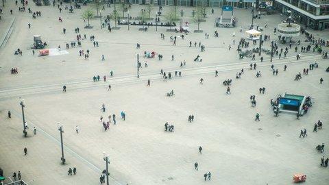 Aerial view of busy crowd walking in Alexanderplatz, Berlin, Germany