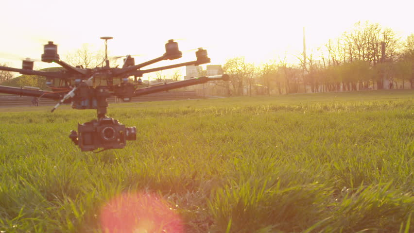 SLOW MOTION: Drone flying low above the field