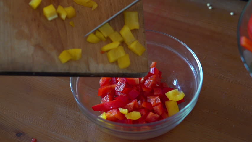 Putting chopped pepper into bowl, super slow motion, shot at 240fps
