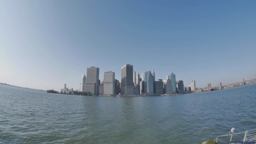 New York - March, 2014 - Wide shot of Downtown Manhattan from a ferry ride.